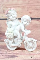 Anjelikovia sediaci na bicykli (v.11cm)