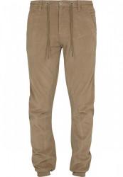 Pánske olivové menčestrové nohavice URBAN CLASSICS Corduroy Jog Pants sand